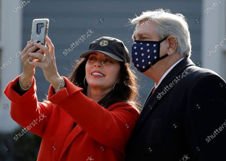 Stock Photo of Lynn Anderson, left, takes a photo of herself with her husband John Anderson after both voted at the Town Hall, in Walden, Tenn