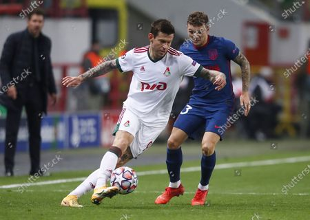Fyodor Smolov (L) of Lokomotiv Moscow in action against Manu Sanchez (R) of Atletico Madrid during the UEFA Champions League group A soccer match between Lokomotiv Moscow and Atletico Madrid in Moscow, Russia, 03 November 2020.