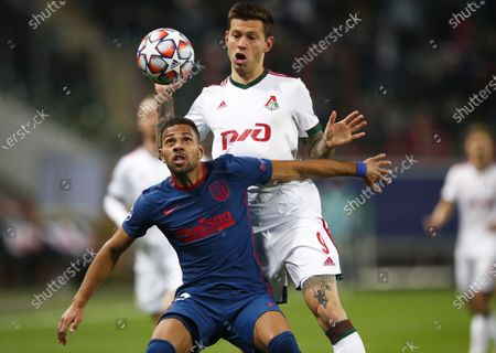 Stock Picture of Fyodor Smolov (back) of Lokomotiv Moscow in action against Renan Lodi (front) of Atletico Madrid during the UEFA Champions League group A soccer match between Lokomotiv Moscow and Atletico Madrid in Moscow, Russia, 03 November 2020.
