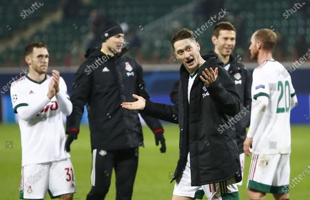 Anton Miranchuk (C) of Lokomotiv Moscow reacts after the UEFA Champions League group A soccer match between Lokomotiv Moscow and Atletico Madrid in Moscow, Russia, 03 November 2020.