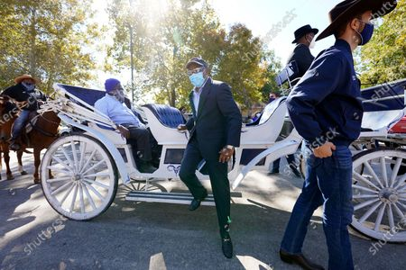 Stock Image of Houston Mayor Sylvester Turner, center, and Harris County Clerk Chris Hollins, right, arrive a voting site, in Houston