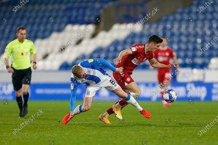 Bristol City FC Midfielder Liam Walsh (8) and Huddersfield Town AFC Midfielder Lewis O'Brien (8) compete for the ball during the EFL Sky Bet Championship match between Huddersfield Town and Bristol City at the John Smiths Stadium, Huddersfield