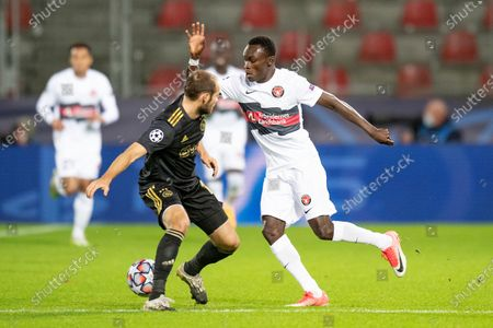 FC Midtjyllands Pione Sisto (R) and Ajax Daley Blind during the UEFA Champions League group D soccer match between FC Midtjylland and Ajax Amsterdam, in Herning, Denmark, 03 November 2020.