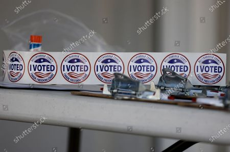 I voted stickers rest on a poll workers table during the 2020 US presidential election at the Robert L. Gilder Elections Service Center in Tampa, USA, 03 November 2020. Americans vote on Election Day to choose between re-electing Donald J. Trump or electing Joe Biden as the 46th President of the United States to serve from 2021 through 2024.