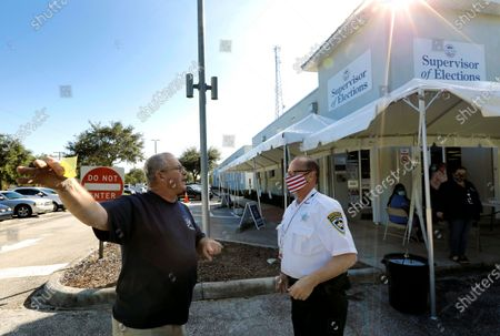 An unidentified man (L) tells a Hillsborough Sheriff, he wants to report voter fraud in the 2020 US presidential election at the Robert L. Gilder Elections Service Center in Tampa, USA, 03 November 2020. Americans vote on Election Day to choose between re-electing Donald J. Trump or electing Joe Biden as the 46th President of the United States to serve from 2021 through 2024.