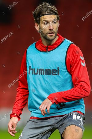 Fleetwood Town defender Charlie Mulgrew (14) warms up prior to the EFL Sky Bet League 1 match between Charlton Athletic and Fleetwood Town at The Valley, London