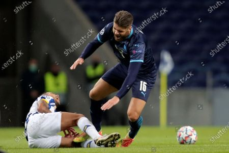 Porto's Jesus Corona grimaces on the ground as Marseille's Duje Caleta-Car steps on his leg during the Champions League group C soccer match between FC Porto and Olympique de Marseille at the Dragao stadium in Porto, Portugal