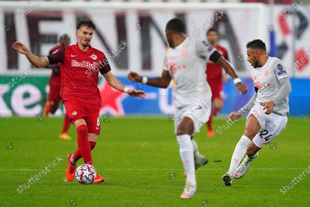 Salzburg's Mergim Berisha in action against Bayern's Corentin Tolisso (R) during the UEFA Champions League Group A soccer match between RB Salzburg and FC Bayern Munich, in Salzburg, Austria, 03 November 2020.