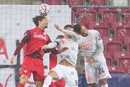 (L-R) Salzburg's Andre Ramalho, Bayern's Robert Lewandowski and Bayern's Corentin Tolisso vie for the ball  during the UEFA Champions League Group A soccer match between RB Salzburg and FC Bayern Munich, in Salzburg, Austria, 03 November 2020.