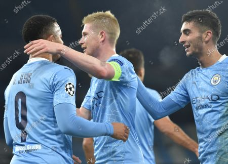 Manchester City's Gabriel Jesus (L) celebrates with Kevin De Bruyne (C) and Ferran Torres (R) after scoring the 2-0 goal during the UEFA Champions League group C soccer match between Manchester City and Olympiacos Piraeus in Manchester, Britain, 03 November 2020.