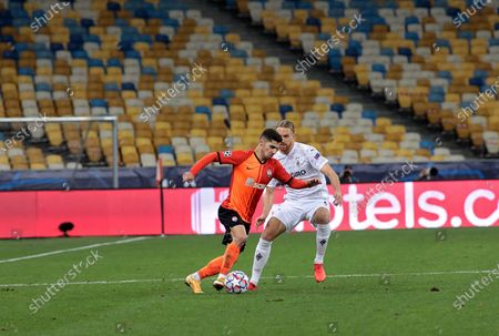 Stock Image of Midfielder Manor Solomon (L) of FC Shakhtar Donetsk and defender Michael Lang of Borussia Monchengladbach are seen in action during the UEFA Champions League Group B game at the NSC Olimpiyskiy, Kyiv, capital of Ukraine.