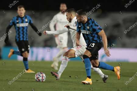 Real Madrid's Eden Hazard, left, controls the ball as Inter Milan's Danilo D'Ambrosio tries to stop him during the Champions League group B soccer match between Real Madrid and Inter Milan at the Alfredo Di Stefano stadium in Madrid, Spain