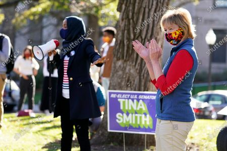 Stock Photo of Sen.Tina Smith, right, D-Minn.,applauds as Democrat U.S. Rep. Ilhan Omar addresses students at the University of Minnesota on Election Day, in Minneapolis.Smith faces Republican Jason Lewis in the Senate race in Minnesota