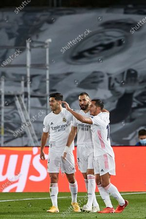 Karim Benzema of Real Madrid celebrates with his teammates after scoring the 1-0
