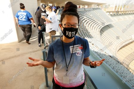 Stock Photo of Olivia Tai reflects after voting on election Tuesday at Dodger Stadium in Elysian Park. For Nita Lelyveld story. Dodgers Stadium on Tuesday, Nov. 3, 2020 in Los Angeles, CA. (Al Seib / Los Angeles Times