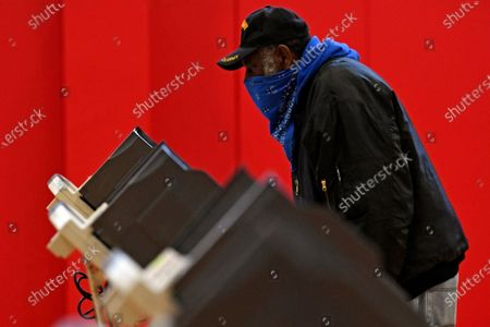 Stock Picture of Robert Powell casts his ballot at Alliance High School, in Alliance, Ohio