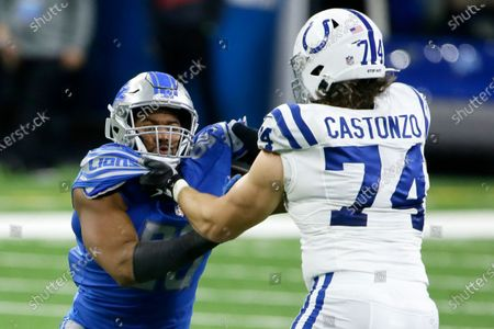 Detroit Lions defensive end Trey Flowers (90) is held Indianapolis Colts offensive tackle Anthony Castonzo (74) during the first half of an NFL football game against the Indianapolis Colts, in Detroit