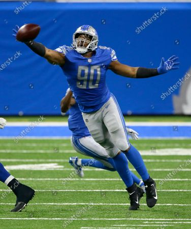 Detroit Lions defensive end Trey Flowers (90) tries to knock down a Indianapolis Colts pass during the first half of an NFL football game, in Detroit