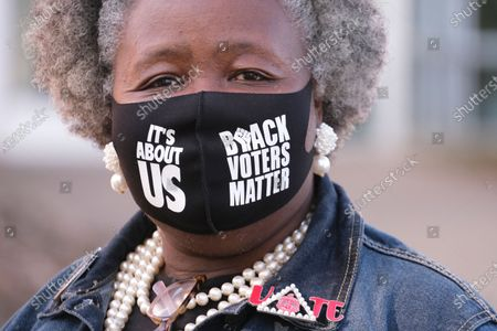 Beverly Johnson wears a Black Voters Matter mask while welcoming voters outside of a polling place at the Hadley Park Community Center in Nashville, Tennessee on 03 November 2020. Americans vote on Election Day to choose between re-electing Donald J. Trump or electing Joe Biden as the 46th President of the United States to serve from 2021 through 2024.