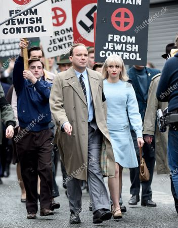 Exclusive - Aggi O'Casey (blue dress) stars as young Jewish woman, Vivien Epstein in the BBC neo-Nazi thriller Ridley Road. Rory Kinnear co stars as racist leader Colin Jordan. The streets of Ashton were dressed for the early sixties.