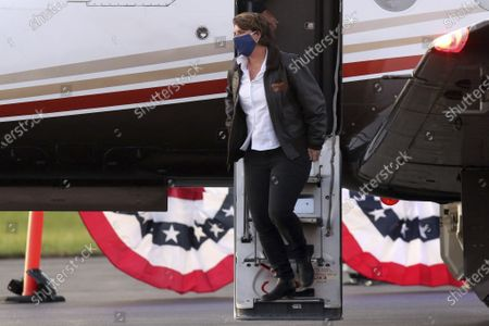 Democratic U.S. Senate candidate Amy McGrath gets off the plane at Georgetown-Scott County Regional Airport, Georgetown, Ky., . McGrath flew to several campaign stops on Election Day
