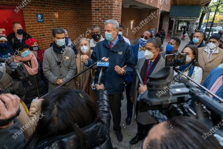 Stock Picture of New York City Mayor Bill de Blasio (center) along with City council member Ydanis Rodriguez, Manhattan Borough President Gale Brewer, US Congressman Adriano Espaillat wearing face masks attend to the press outside a polling site in Manhattan during the 2020 U.S Presidential Election in New York City.