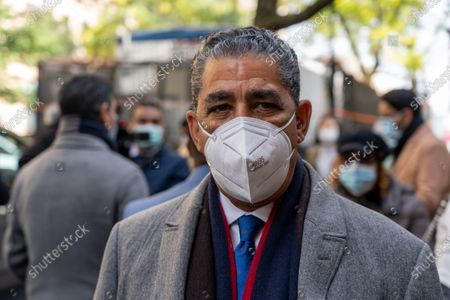 Stock Image of US Congressman Adriano Espaillat wearing a face mask speaks to the press outside a polling site in Manhattan during the 2020 U.S Presidential Election in New York City.
