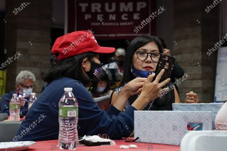 Stephanie Nguyen, left, and Michelle Do wait for election results with other supporters of President Donald Trump, in Stanton, Calif