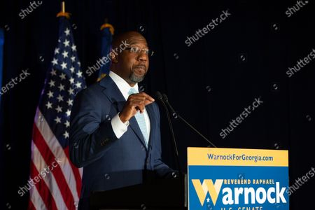Democratic U.S. Senate candidate Rev. Raphael Warnock speaks during an Election Night event in Atlanta, Georgia, USA, 03 November 2020. Democratic Senate candidate Rev. Raphael Warnock is running in a special election against a crowded field, including U.S. Sen. Kelly Loeffler (R-GA), who was appointed by Gov. Brian Kemp to replace Johnny Isakson at the end of last year. Georgia is the only state with two Senate seats on the 03 November ballot.