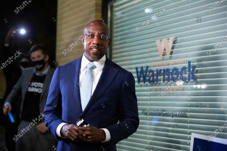 Democratic US Senate candidate Rev. Raphael Warnock greets supporters and staff as he enters his campaign headquarters in Atlanta, Georgia, USA, 03 November 2020. Democratic Senate candidate Rev. Raphael Warnock is running in a special election against a crowded field, including U.S. Sen. Kelly Loeffler (R-GA), who was appointed by Gov. Brian Kemp to replace Johnny Isakson at the end of last year. Georgia is the only state with two Senate seats on the 03 November ballot.