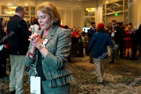 Supporter Cathy Harrison for Republican candidate Sen. Kelly Loeffler reacts at an election night watch party for Loeffler, in Atlanta