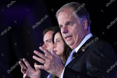 Sen. Doug Jones delivers his concession speech, during his election night watch party in Birmingham, Ala. Jones his seat to Republican Tommy Tuberville