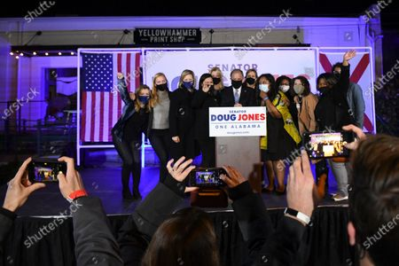 Sen. Doug Jones, D-Alabama, takes a photo with supporters following his concession speech, in Birmingham, Ala. Jones lost to Republican Tommy Tuberville