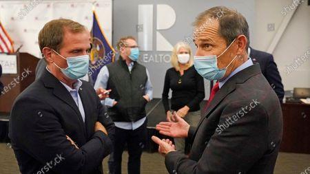 Republican incumbents U.S. Reps. Chris Stewart, left, and John Curtis talk during an Utah Republican election night party, in Sandy, Utah