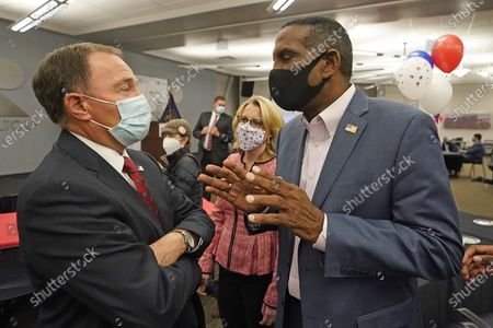 Utah Gov. Gary Herbert, left, speaks with Burgess Owens, the Republican candidate in Utah's 4th Congressional District, during a Utah Republican election night party, in Sandy, Utah