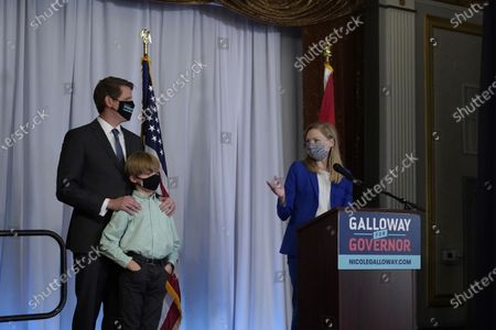 Stock Image of Missouri Auditor Nicole Galloway delivers a concession speech as he husband Jon and son William stand nearby, in Columbia, Mo. Galloway, a Democrat, has lost to incumbent Republican Gov. Mike Parson in the race for Missouri governor