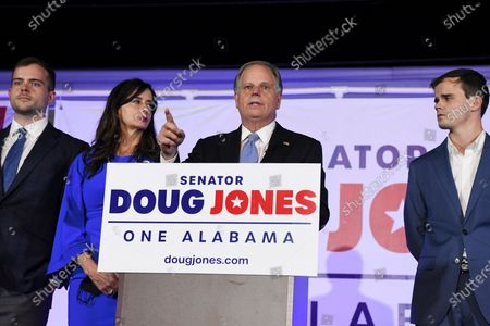 Stock Image of Sen. Doug Jones delivers his concession speech surrounded by family during his election night watch party, in Birmingham, Ala. Jones lost his seat to Republican Tommy Tuberville