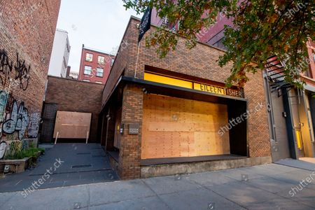 The Eileen Fisher store front is boarded up in fear of post election violence in the SoHo area in the borough of Manhattan