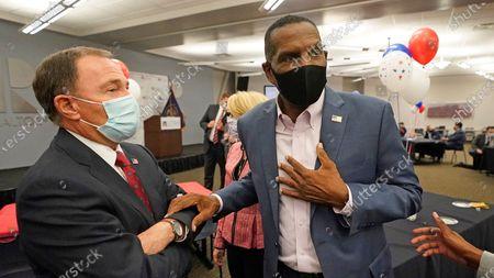 Utah Gov. Gary Herbert, left, speaks with Burgess Owens, Republican candidate in Utah's 4th Congressional District, during an Utah Republican election night party, in Sandy, Utah