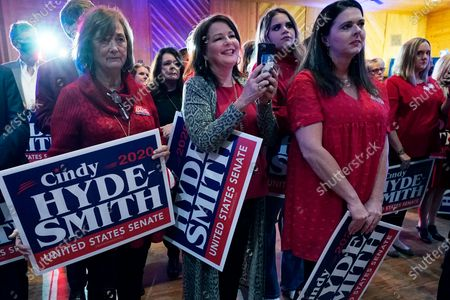 Supporters of U.S. Sen. Cindy Hyde-Smith, R-Miss., listen to her victory speech in Jackson, Miss., . Hyde-Smith beat Democrat Mike Espy and Libertarian Jimmy Edwards