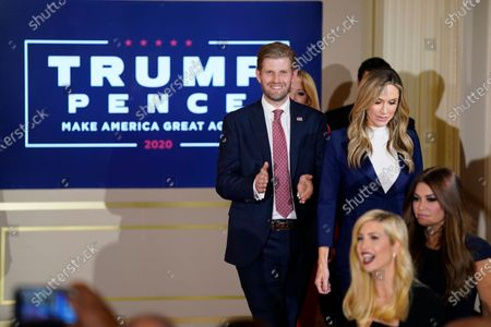 Eric Trump and his wife Lara Trump arrive to hear President Donald Trump speak in the East Room of the White House, early, in Washington. At lower right is Ivanka Trump and Kimberly Guilfoyle
