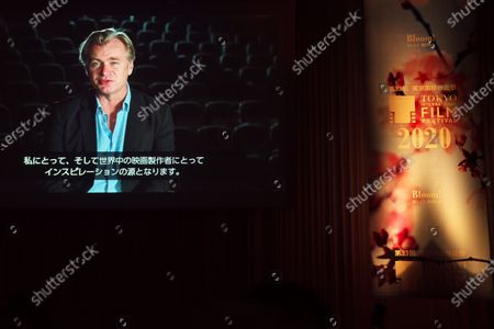 Stock Photo of A video message by director Christopher Nolan is screened during a opening ceremony for The 33rd Tokyo International Film festival in Tokyo, Japan.