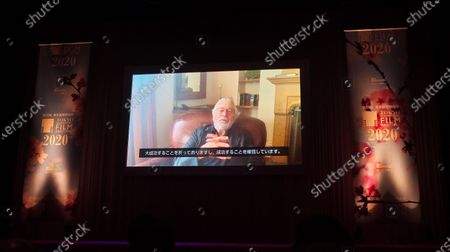 A video message by actor and director Robert De Niro is screened during a opening ceremony for The 33rd Tokyo International Film festival in Tokyo, Japan.