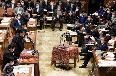 Opposition leader of the Constitutional Democratic Party of Japan, Yukio Edano questions to Suga at Lower House's budget committee session at the National Diet in Tokyo, Japan.