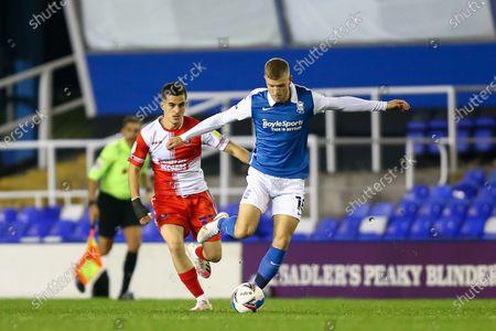 Riley McGree (18) of Birmingham City dribbles the ball