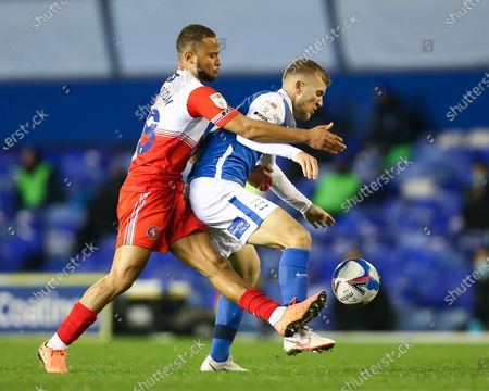 Riley McGree (18) of Birmingham City is fouled by Curtis Thompson (18) of Wycombe Wanderers