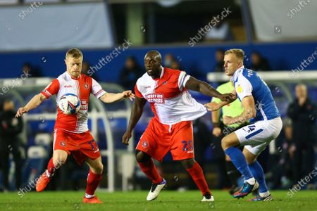 Daryl Horgan (17) of Wycombe Wanderers, Adebayo Akinfenwa (20) of Wycombe Wanderers and Marc Roberts (4) of Birmingham City compete for the ball