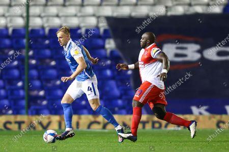 Marc Roberts (4) of Birmingham City dribbles the ball away from Adebayo Akinfenwa (20) of Wycombe Wanderers