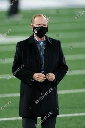 New York Giants owner John Mara walks on the field before an NFL football game against the Tampa Bay Buccaneers, in East Rutherford, N.J