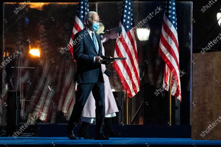 Democratic Candidate and former Vice President Joe Biden (L) and his wife Dr. Jill Biden (R) greet attendees during his Election Night event at the Chase Center in Wilmington, Delaware, USA, early 04 November 2020. The 2020 Presidential Election result remains undetermined as poll workers continue to count ballots in several key battleground states.